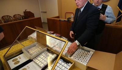 Appraiser Howard Herz talks about gold coins being auctioned off more in Carson City, Nev., on Tuesday, Feb. 26, 2013. Sixty-nine-year-old Walter Samaszko, Jr. died in June 2012, leavin