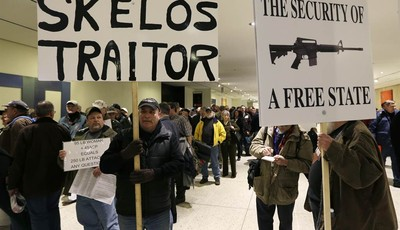 Gun rights advocates wait in a security line on the main concourse at the Empire State Plaza before entering the Capitol and Legislative Office Building on Thursday, Feb. 28, 2013, in A