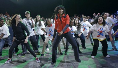 First lady Michelle Obama exercises with children from Chicago Public Schools, in her hometown of Chicago, as she makes a major announcement helping to bring back physical activity to a