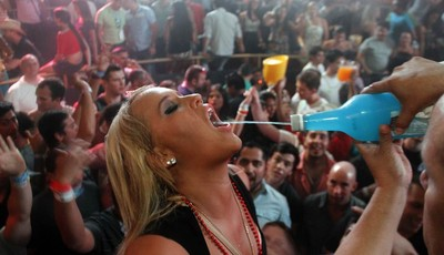A spring break reveler gets a drink at a bar in the resort city of Cancun, Mexico, early Tuesday Feb. 26, 2013. Cancun is one of the No. 1 foreign destination for U.S. college students