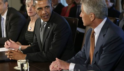 President Barack Obama welcomes his new Defense Secretary Chuck Hagel, right, as he speaks to members of the media at the start of a cabinet meeting in the Cabinet Room of the White Hou