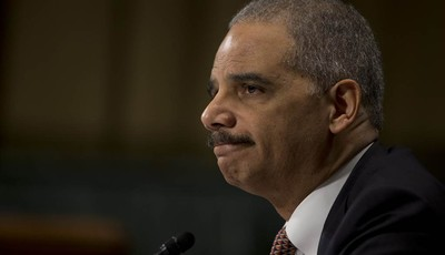"Attorney General Eric Holder pauses as he testifies on Capitol Hill in Washington, Wednesday, March 6, 2013, before the Senate Judiciary Committee hearing: ""Oversight of the U.S. Depart"