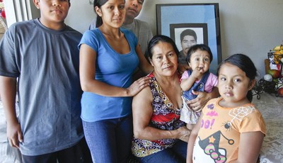 In this June 25, 2012 photo, Juana Garcia Martinez, seated center, poses with her family, from left, son Carlos, 12, daughter Gladys Dominguez, 19, son Victor, 19, granddaughter Jazleen