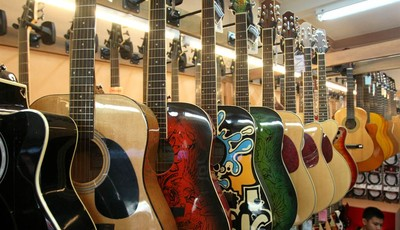 Guitars are on display at a musical instrument shop in Bangkok, Thailand, Friday, March 8, 2013. Delegates attending a global biodiversity conference in Bangkok this week are debating a