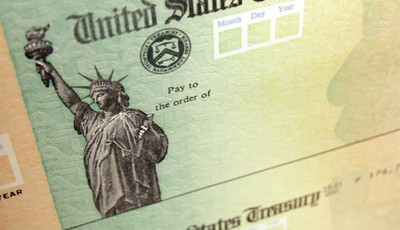 FILE - In this May 8, 2008, file photo, blank U.S. Treasury checks are seen on an idle press at the Philadelphia Regional Financial Center, which disburses payments on behalf of federal