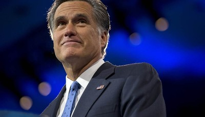 Former Massachusetts Gov., and 2012 Republican presidential candidate, Mitt Romney pauses while speaking at the 40th annual Conservative Political Action Conference in National Harbor,