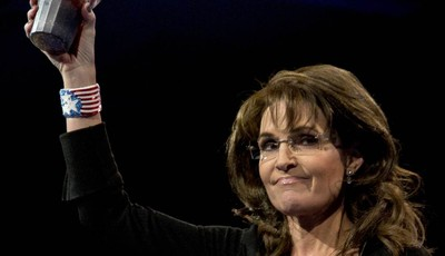 Former Alaska Gov. Sarah Palin holds up a 7-Eleven Super Big Gulp soda on stage at the 40th annual Conservative Political Action Conference in National Harbor, Md., Saturday, March 16,
