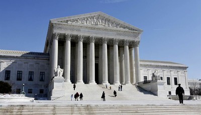 FILE- This March 5, 2009, file photo shows the U.S. Supreme Court building in Washington. The Supreme Court argued Monday, March 18, 2013 over whether states fighting voter fraud and il