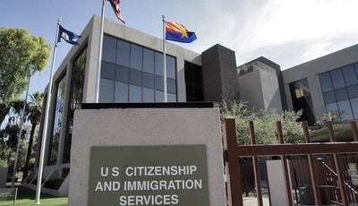 FILE – This Aug. 5, 2008, file photo shows the U.S. Citizenship and Immigration Services building Phoenix. The Supreme Court argued Monday, March 18, 2013 over whether states fighting v
