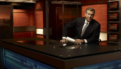 """This 2009 photo released by NBC shows Brian Williams on the set of """"Nightly News with Brian Williams,"""" in New York. ABC, CBS, NBC evening newscasts had 11 percent fewer viewers because"""