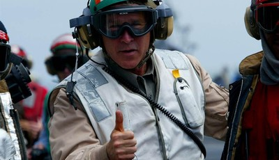 FILE - U.S. President George W. Bush gives a thumbs up as he visits the aircraft carrier USS Abraham Lincoln off the California coast on Thursday, May 1, 2003. Later in the day, he decl