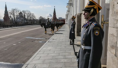 Honor guards stand at the Grand Kremlin Palace for a meeting of Russian President Vladimir Putin and Chinese President Xi Jinping in the Kremlin in Moscow, Friday, March 22, 2013. Russi