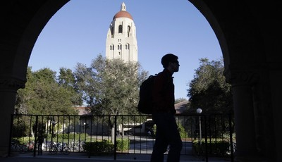 FILE - In this Feb. 15, 2012 file photo, a Stanford University student walks in front of Hoover Tower on the Stanford University campus in Palo Alto, Calif. Congressional inaction could