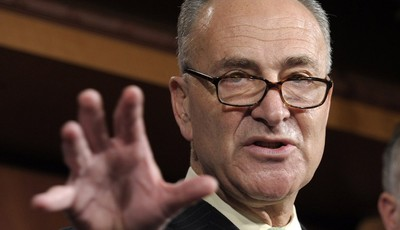 FILE - In this May 17, 2012 file photo, Sen. Charles Schumer, D-N.Y. gestures during a news conference on Capitol Hill in Washington. Big business and major labor unions appeared ready