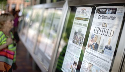 FILE – In this June 29, 2012 file photo front pages of the days