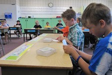 -                In this photo taken May 9, 2012, Dillon Elledge, 8, right, and Brody Kemble, 7, second from right, work with flash cards in their all-boys classroom at Middleton Heights Elementary in M