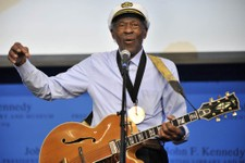 """-                FILE - This Feb. 26, 2012 file photo, musician Chuck Berry plays """"Johnny B. Goode"""" at the John F. Kennedy Presidential Library and Museum in Boston. Berry will be honored this fall by t"""