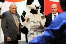 -                FILE - In this Monday, Dec. 14, 2009 file picture, Chick-fil-a founder Truett Cathy, left, and his son Dan Cathy pose for a photo with the Chick-fil-A cows during a celebration of passi