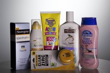-                FILE - In this May 26, 2010 file photo, various sunscreen products are seen in Washington.  When the Obama administration agreed to set the first-ever federal limits on runoff in Florid