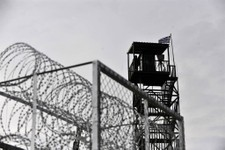 -                FILE - In this Monday, Feb. 6, 2012 Greek soldier is seen on a military observatory tower, on the construction site of a border fence aimed at stemming illegal immigration, in the villa
