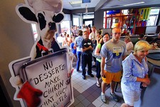 -                Customers stand in a long line at the Chick-fil-A  in Columbus, Ga., Wednesday, Aug. 1, 2012. Chick-fil-A supporters are eating at restaurants in the chicken chain as the company contin