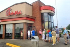 -                Customers line up outside the Chick-fil-A Restaurant at New Bern Mall on Wednesday, Aug. 1, 2012 in New Bern, N.C.  Supporters of Chick-fil-A are planning to eat at restaurants in the c