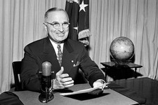 -                FILE - In this Sept. 1, 1945 file photo, then-U.S. President Harry Truman sits before a microphone at the White House in Washington, where he broadcast a message on the formal surrender