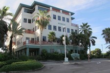 -                In this Aug. 3, 2012 photo, the Ugland House, the registered office for thousands of global companies, stands in George Town on Grand Cayman Island. The Cayman Islands have lost some of