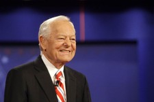 -                FILE - In this Oct. 15, 2008 file photo, moderator Bob Schieffer smiles at the start of a presidential debate at Hofstra University in Hempstead, N.Y. For the first time in two decades,