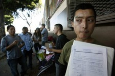 -                Illegal immigrant Layios Roberto waits outside the offices of Coalition for Humane Immigrant Rights in Los Angeles Wednesday, Aug. 15,  2012.  Hundreds of thousands of young illegal imm