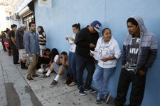 -                A line of legal immigrants wait outside the Coalition for Humane Immigrant Rights in Los Angeles offices Wednesday, Aug. 15,  2012.  Hundreds of thousands of young illegal immigrants sc