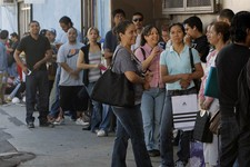 -                A line of illegal immigrants wait outside the Coalition for Humane Immigrant Rights in Los Angeles offices Wednesday, Aug. 15,  2012. Hundreds of thousands of young illegal immigrants s