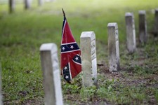 -                A confederate flag is seen at a tombstone on the cemetery at  Beauvoir House, Jefferson Davis' historic home, in Biloxi, Miss., Thursday, Aug. 16, 2012.  Commemorating the 150th anniver
