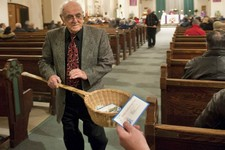 -                In this Saturday, Dec. 19, 2009 photo, John Alves, of Dartmouth, Mass., uses a basket while taking collection during Mass at St. John the Baptist Roman Catholic Church in New Bedford, M
