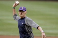 -                Political consultant James Carville throws out an honorary first pitch before a baseball game between the Washington Nationals and the Atlanta Braves at Nationals Park on Tuesday, Aug.