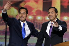 -                San Antonio Mayor Julian Castro and his brother Joaquin Castro, right, wave to the Democratic National Convention in Charlotte, N.C., on Tuesday, Sept. 4, 2012. (AP Photo/J. Scott Apple