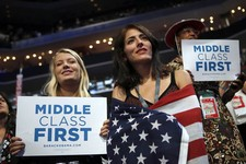-                In this Spet. 5, 2012, photo, delegates watch as former President Bill Clinton addresses the Democratic National Convention in Charlotte, N.C. The placards on display as Clinton address