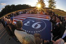-                Visitors to the Flight 93 National Memorial in Shanksville, Pa., participate in a sunset memorial service on Monday, Sept. 10, 2012. Tuesday marks the 11th anniversary of the Sept. 11,