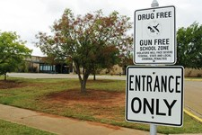 -                A sign declaring Stillwater Junior High School as a drug free and gun free zone is pictured outside the school in Stillwater, Okla., Wednesday, Sept. 26, 2012.  A 13-year-old student sh