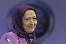 -                FILE - In this Jan. 25, 2011 file photo, Maryam Rajavi, President-elect of Iranian opposition party National Council of Resistance of Iran, smiles as she attends an international confer