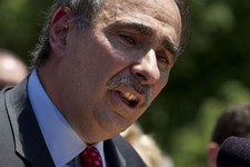-                In this photo taken May 31, 2012, Obama adviser David Axelrod speaks to a crowd in front of the Statehouse, in Boston, where he criticized the gubernatorial record of Republican preside