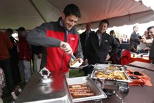 -                Republican vice presidential candidate, Rep. Paul Ryan, R-Wis., puts food on his plate at a Bowling Green State University and Miami University of Ohio football game tailgate party, Sat