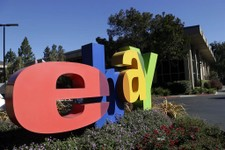 -                An eBay sign decorates the front of the company's headquarters in San Jose, Calif., Wednesday, Oct.  17, 2012. EBay said its third-quarter net income grew 22 percent, helped by higher r
