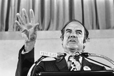 -                FILE - In this July 30, 1971 file photo, Sen. George McGovern gestures during his keynote address at the National Welfare Rights Organization convention at Brown University in  Providen