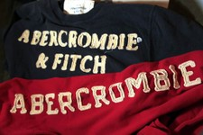 -                In this Nov. 14, 2011 photo, Abercrombie & Fitch sweat shirts are displayed at a store in Phoenix. When it comes to flying, it seems that Abercrombie & Fitch CEO Michael S. Jeffries is