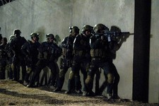 "-                This film image released by National Geographic Channels shows actors portraying members of SEAL Team Six who raided the compound of Osama Bin Laden in ""SEAL Team Six: The Raid on Osama"