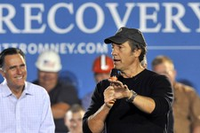 "-                FILE - In this Sept. 26, 2012 file photo, Republican presidential candidate, former Massachusetts Gov. Mitt Romney listens as Mike Rowe, host of television show ""Dirty Jobs"" speaks duri"