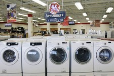 -                This Oct. 25, 2012 photo shows appliances on display at Orville's Home Appliances store in Amherst, N.Y.  The government's snapshot Friday, Oct. 26, 2012,  of the U.S. economy's growth