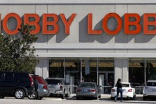 -                Customers walk to a Hobby Lobby store in Dallas on Thursday, Nov. 1, 2012. The arts and craft supply company owned by a Christian family asked a judge Thursday, Nov. 1, 2012 to block a
