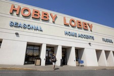 -                FILE - In this Sept. 12, 2012 file photo, a woman walks from a Hobby Lobby Inc., store in Little Rock, Ark. Hobby Lobby Stores, the arts and craft supply chain that wants to block enfor